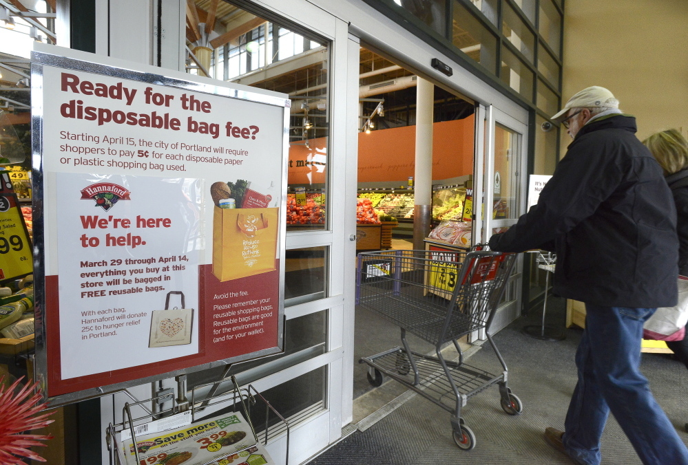 A sign alerts customers at the Hannaford store on Forest Avenue about the disposable bag fee arriving April 15. Hannaford expects to give away about 100,000 reusable bags, and all of the disposable bag fees paid at its two Portland stores will be donated to hunger relief.