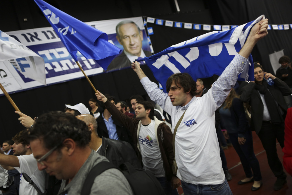 Israeli Prime Minister Benjamin Netanyahu Likud party supporters react to exit poll results at the party's election headquarters In Tel Aviv on Tuesday.
