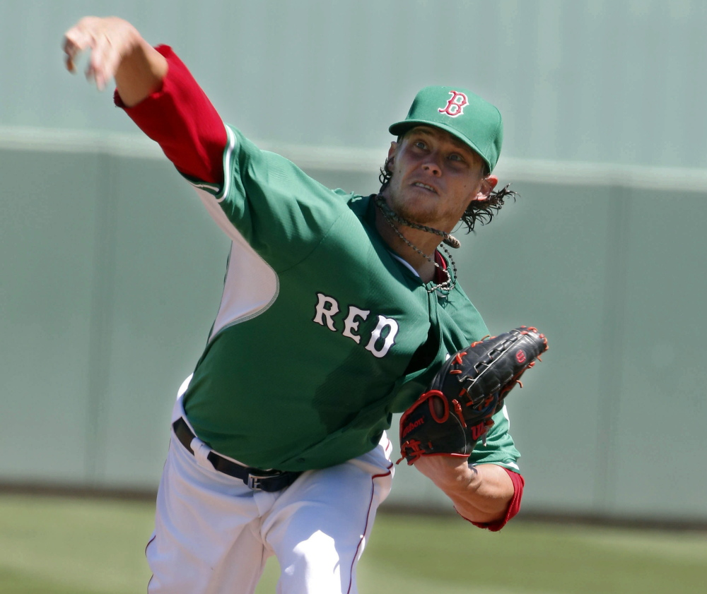 On wearing of the green day, Clay Buchholz allowed four runs, two earned, over four innings Tuesday for the Boston Red Sox in an 11-3 loss to the Atlanta Braves. Buchholz struck out six.