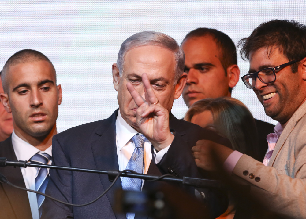 Israeli Prime Minister Benjamin Netanyahu greets supporters at the party's election headquarters in Tel Aviv on Wednesday. The Likud Party's decisive victory in Tuesday's elections marked a stunning comeback in a tight race that had Netanyahu in political jeopardy.