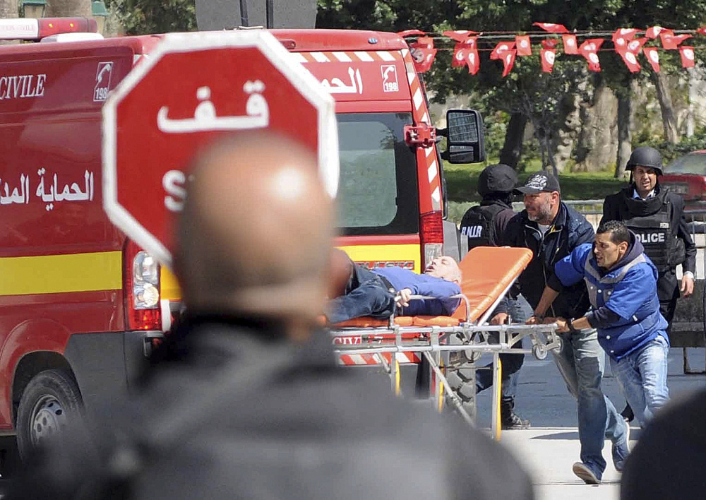 Rescue workers evacuate a victim after gunmen opened fire at the Bardo museum in Tunisia's capital of Tunis on Wednesday.