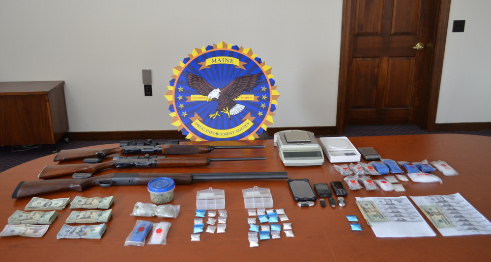 Police display items seized from the home of Travis Hewitt in Caribou on Monday.
