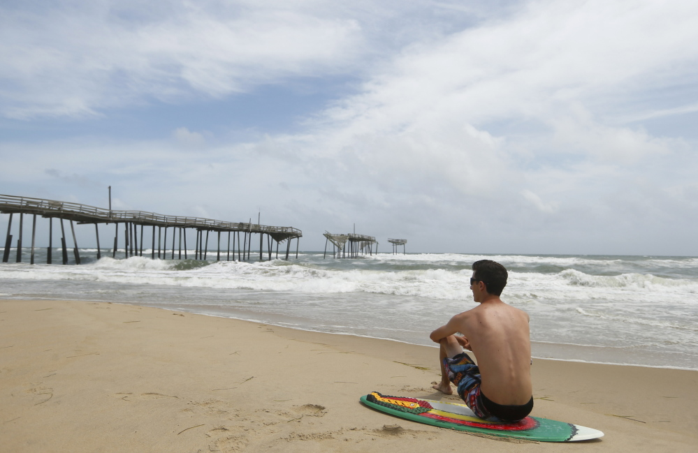 On the beach in Frisco, North Carolina. A proposal to open up some of the East Coast to off-shore drilling has critics warning of catastrophic spills affecting such beaches and the economies of multiple states.