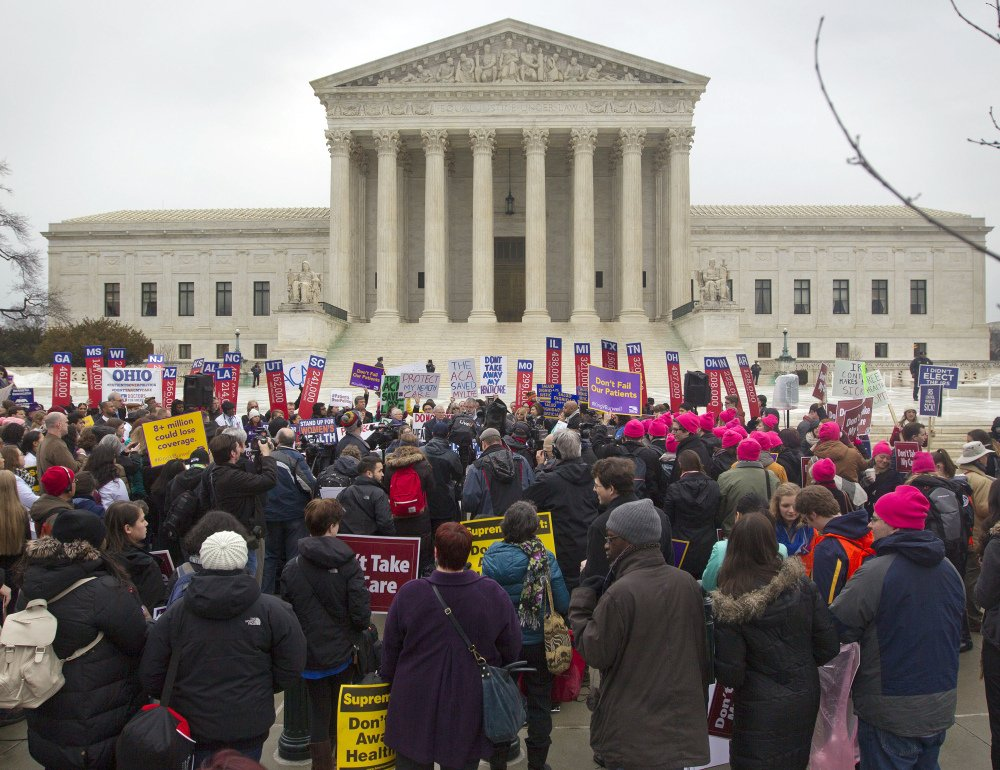 A crowd gathers outside the Supreme Court on March 4 while the court was hearing arguments in a case targeting health insurance subsidies under President Obama's health care law. Maine legislators are considering a bill to protect those subsidies for nearly 67,000 Mainers.