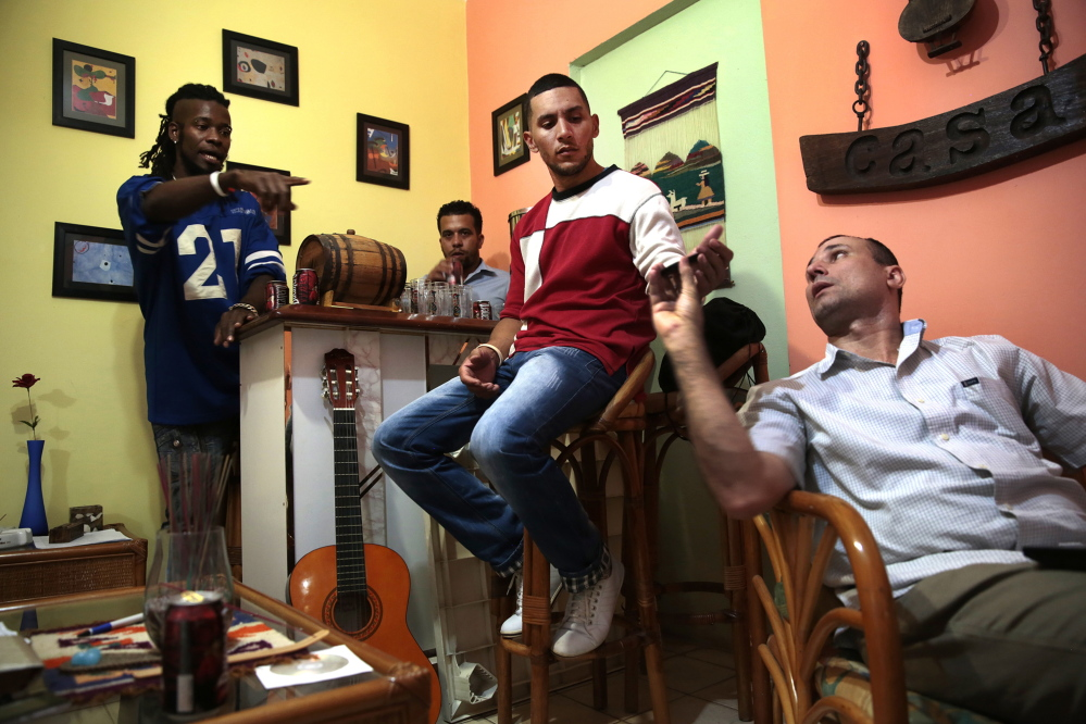 Cubans Omar Sayut, left, Angel Yunier, center, and Jose Daniel Ferrer, right, are very active in the Cuban dissident community. Ferrer spent eight years of a 25-year sentence in a Cuban jail; Yunier was released in January after almost two years in jail. Sayut uses his music to criticize President Raul Castro and his administration.