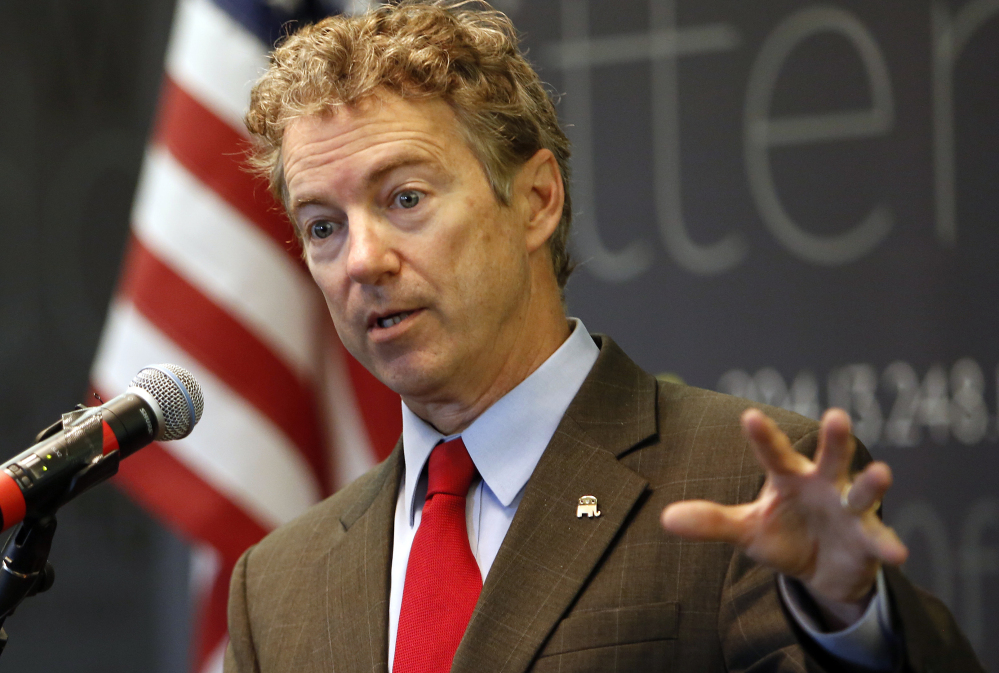 Sen. Rand Paul, R-Ky., speaks to employees at Dyn, an internet performance company, on Friday in Manchester, N.H. Paul is expected to announce his presidential candidacy on April 7.