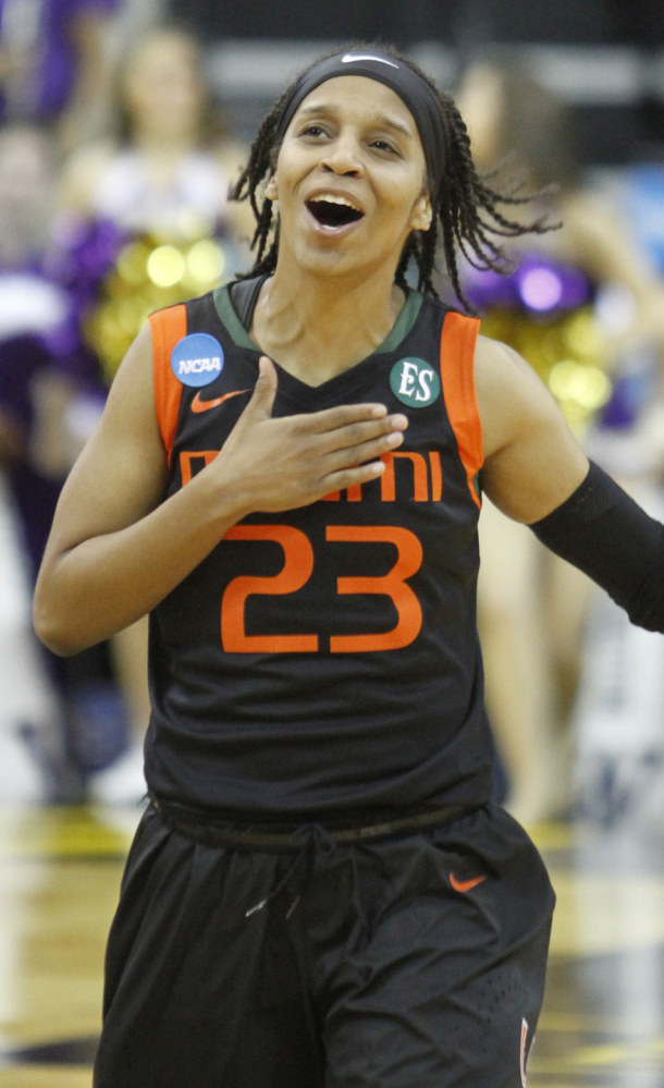 Miami's Adrienne Motley celebrates as she runs off the court after the Hurricanes' upset win over No. 6 Washington on Friday.