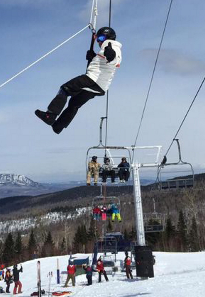 Hank Margolis, of Marlborough, Mass., is evacuated from a chairlift Saturday at the Sugarloaf ski resort in Carrabassett Valley. Margolis said he and his family are regulars at Sugarloaf and were on their 36th day on the mountain when the chairlift malfunctioned.