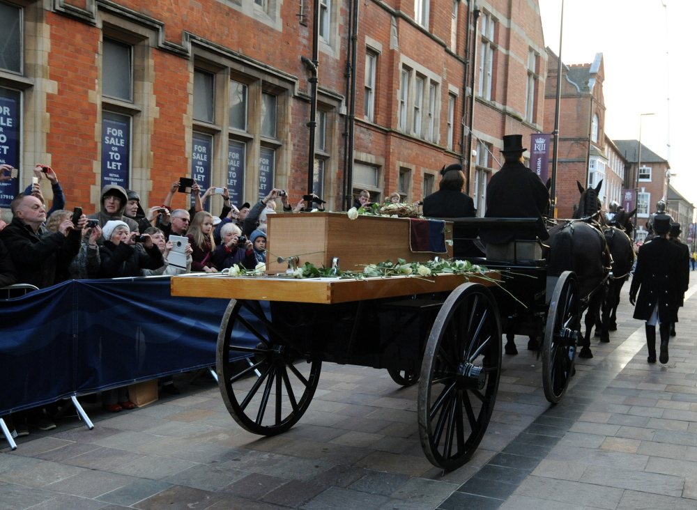 The coffin containing the remains of King Richard III of Shakespeare fame is carried by gun carriage on Sunday through Leicester, England. The crowd included some in period costume and armor, and re-enactors fired cannons at the battlefield where the king died.
