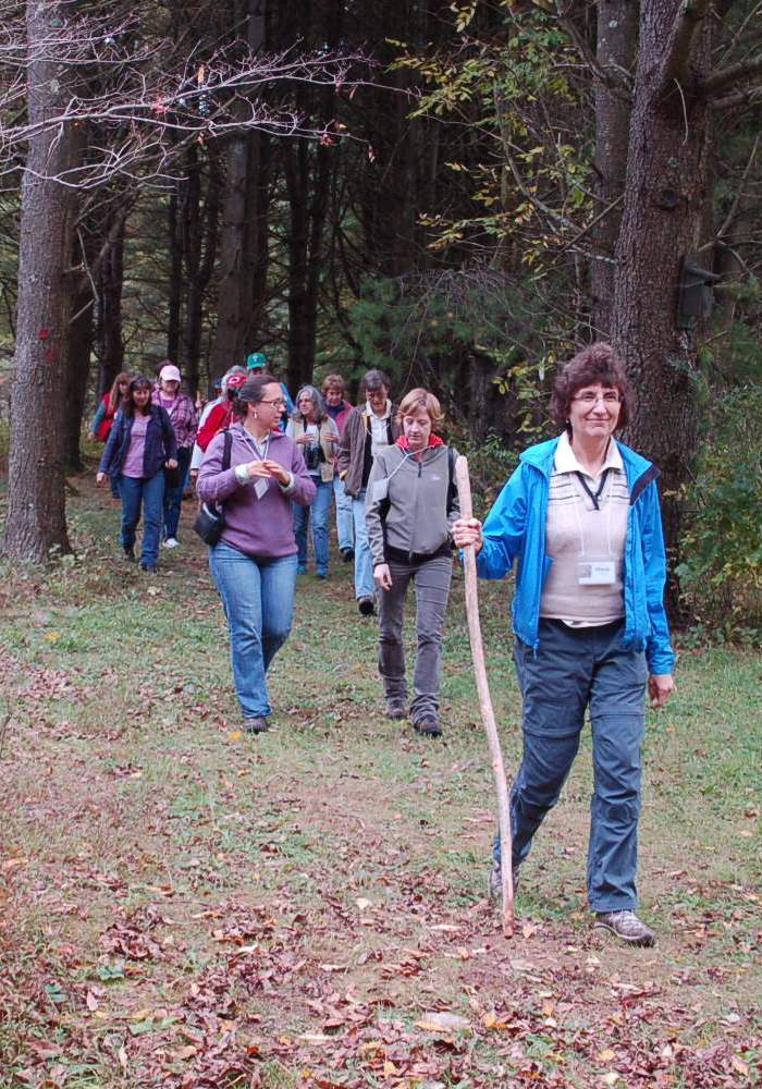A group of women takes a walk along the Wells Reserve campus trails system. A similar outing is planned Wednesday as part of a women's woodlot stewardship workshop being offered there.