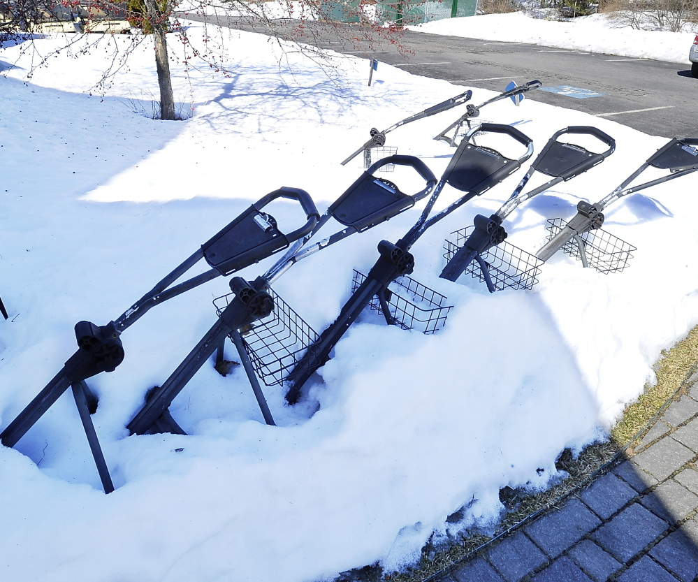 Golf bag carts are still partially buried at Nonesuch River Golf Club in Scarborough, but the course appears to have made it through the winter without damage to its greens.