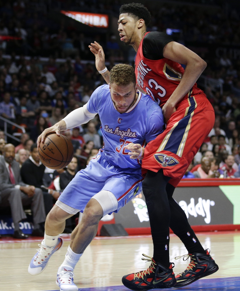 Blake Griffin of the Clippers drives against Anthony Davis of the Pelicans during Sunday's game in Los Angeles. Griffin scored 23 points in a 107-100 victory.