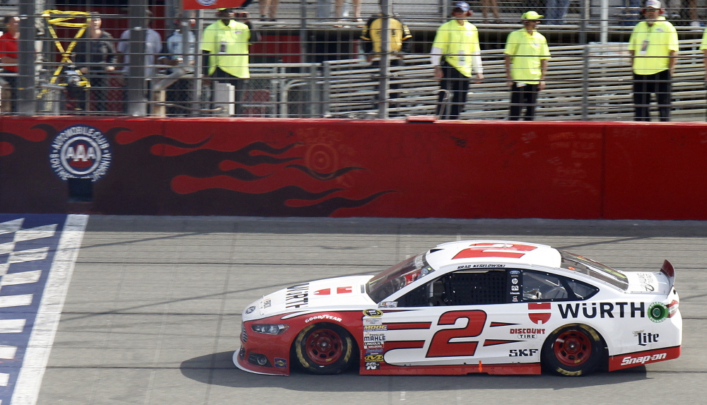 Brad Keselowski seized the lead late from Kurt Busch and held off Kevin Harvick to earn his first NASCAR Sprint Cup Series victory of the season on Sunday in Fontana, Calif.