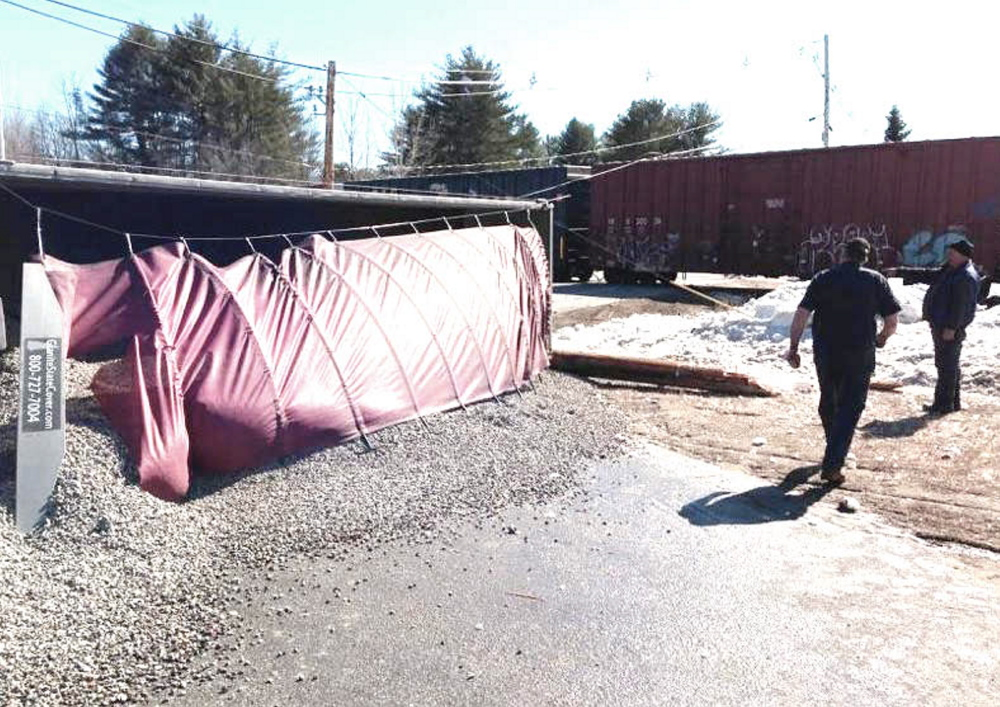 The tractor-trailer spilled its load of gravel after a collision with a train in Auburn on Monday.