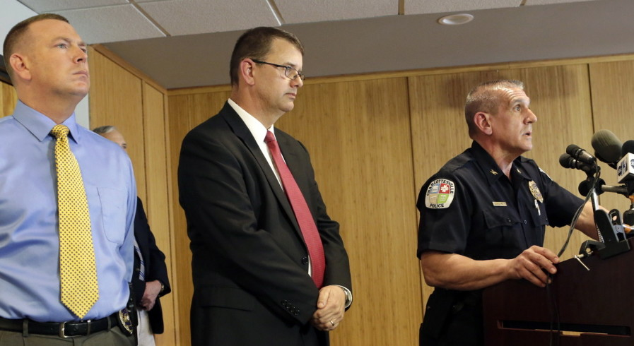 Flanked by detectives, Charlottesville, Va., Police Chief Timothy Longo, right, speaks to journalists on Monday about the police probe into an alleged gang rape at the University of Virginia. Authorities say the case was stymied by the accuser's unwillingness to cooperate.