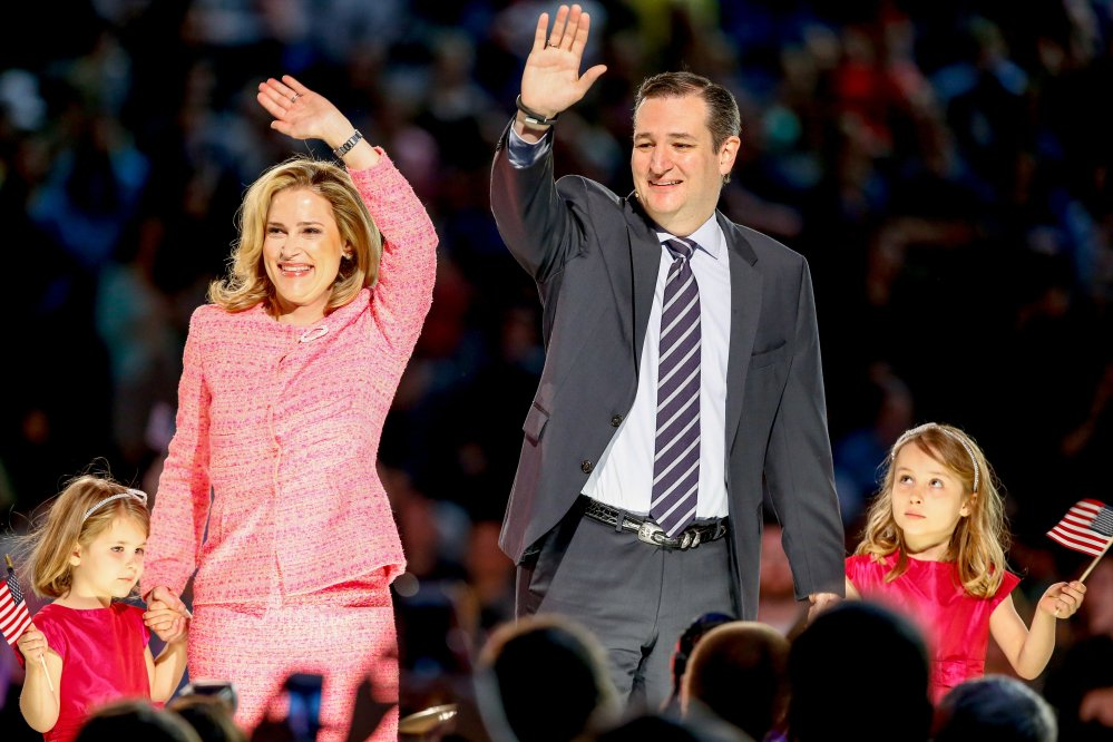 "Sen. Ted Cruz, R-Texas, his wife, Heidi, and their two daughters Catherine, 4, left, and Caroline, 6, right, wave on stage after he announced his campaign for president Monday at Liberty University in Lynchburg, Va. Cruz, the first major declared candidate in the 2016 race for president, has said he wants to be seen as the ""disruptive app"" of Republican politics."