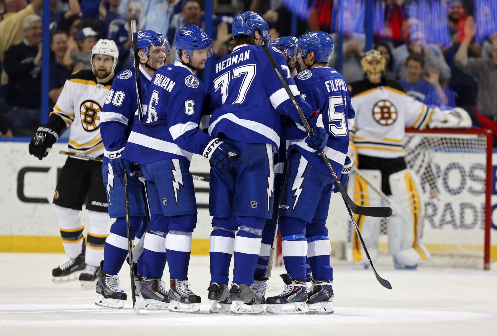 Tampa Bay Lightning celebrate a goal against the Boston Bruins.