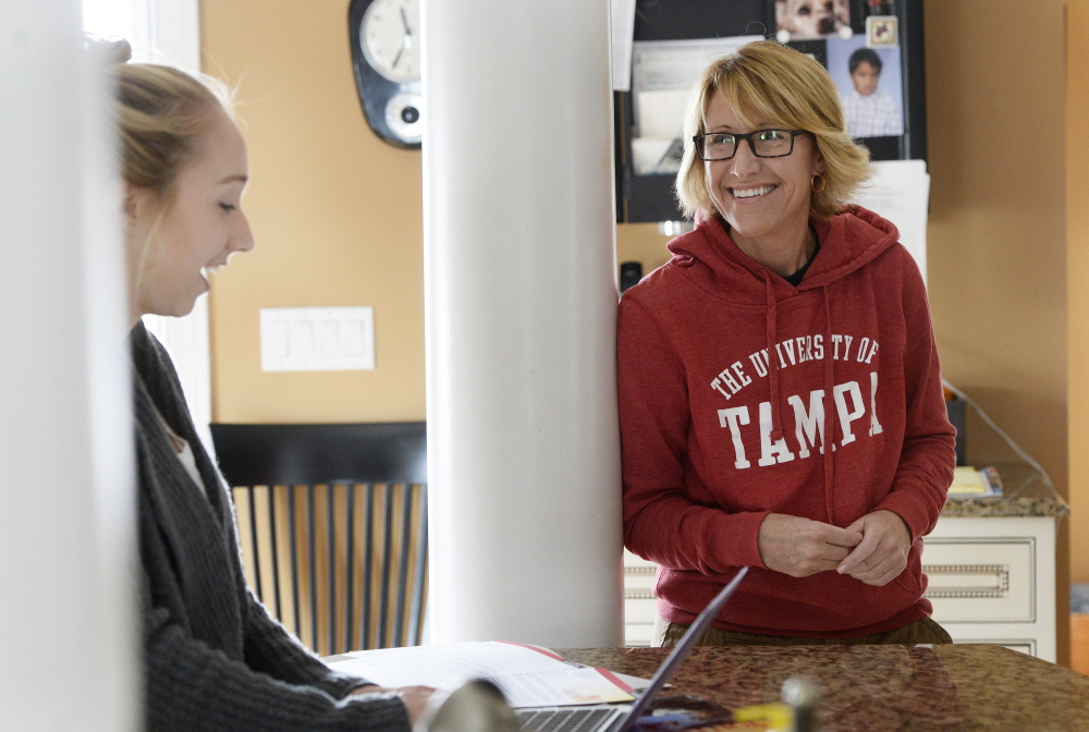 Honors student Gabriella Latini talks with her mother, Christine. She had planned to major in music, then switched to a field of study with more promise of a steady paycheck.