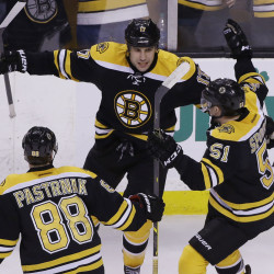 Bruins left wing Milan Lucic (17) celebrates his go-ahead goal against the Florida Panthers with teammates David Pastrnak (88) and Ryan Spooner (51) late in the third period of Tuesday night's game in Boston. Lucic's goal gave the Bruins a 3-2 win.