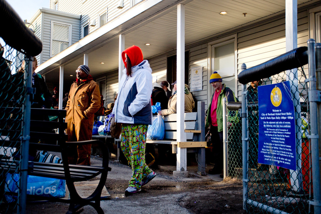 People wait to enter the Oxford Street Shelter in Portland on Monday night. The state provides only $364,000 annually in direct funding to Maine's 42 shelters, and operators say that's far from enough.