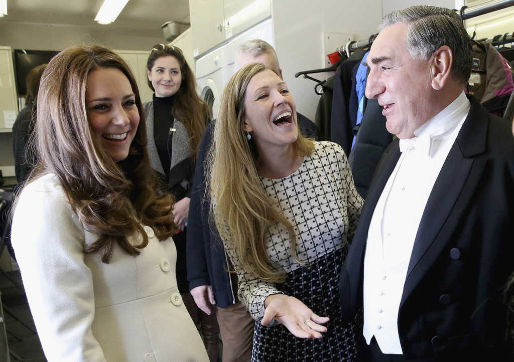 Britain's Kate  Duchess of Cambridge, left,  chats to actor Jim Carter,  who portrays the butler Carson, during a visit to the set of the TV series