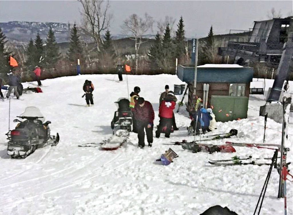 First aid is administered to injured skiers at Sugarloaf Mountain Resort after a chairlift accident Saturday. The Associated Press/Greg Hoffmeister