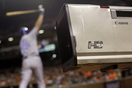 Baseball's take-it-or-leave-it practice of offering only league-wide TV packages of hundreds of games is being challenged in court. The Associated Press