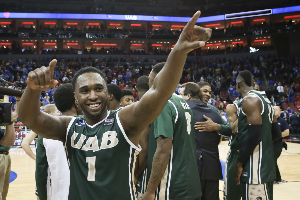 UAB guard Denzell Watts acknowledges the fans as he and his teammates celebrate their 60-59 win over third-seeded Iowa State in an NCAA second-round game at Louisville, Ky. The Associated Press