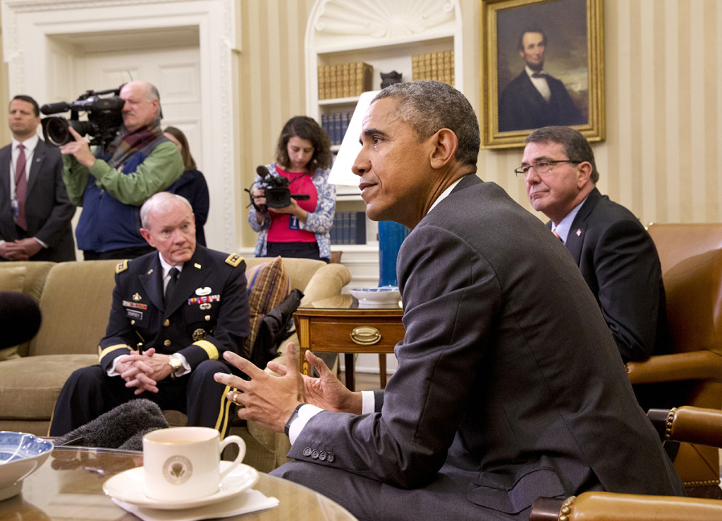 President Barack Obama, accompanied by Defense Secretary Ash Carter, right, and Joint Chiefs Chairman Gen. Martin Dempsey, speaks about Iran and Israeli Prime Minister Benjamin Netanyahu's speech to Congress, Tuesday,  in the Oval Office. The president said Netanyahu didn't offer any