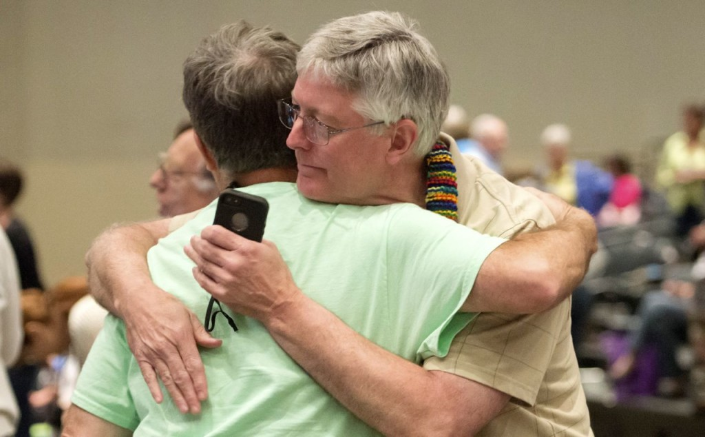 Gary Lyon, left, of Leechburg, Pa., and Bill Samford, of Hawley, Pa., celebrate after a vote allowing Presbyterian pastors discretion in marrying same-sex couples at the 221st General Assembly of the Presbyterian Church in Detroit in this June 19, 2014, photo, The Presbyterian Church (U.S.A.) has now approved redefining marriage in the church constitution to include a