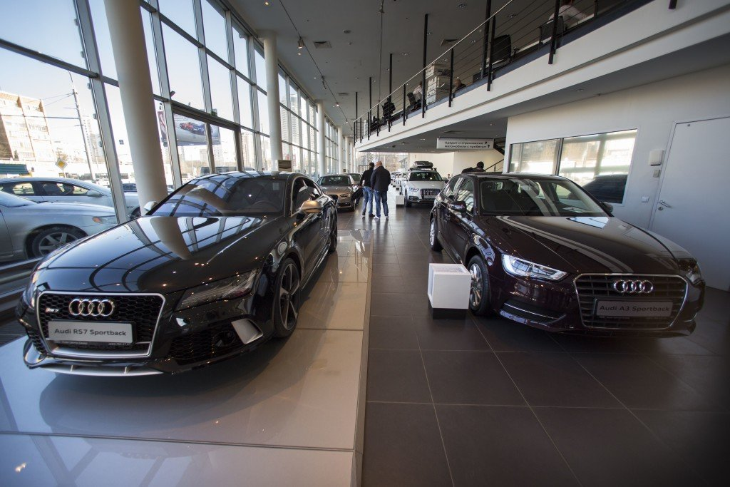 Customers look at cars on display at a  dealership in Moscow. Russian car sales dropped 37.9 percent year-over-year in February,  a sharp contrast to steady rises in Europe overall. The Associated Press