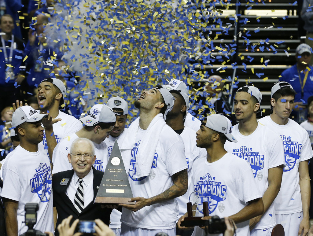 Kentucky forward Willie Cauley-Stein holds the trophy after the NCAA college basketball Southeastern Conference tournament championship game against Arkansas on Sunday. Kentucky goes into the NCAA Tournament undefeated. The Associated Press