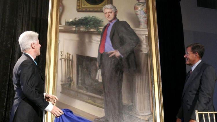 Former President Bill Clinton and Lawrence M. Small, secretary of the Smithsonian Institution, look at Clinton's portrait after its unveiling at the Smithsonian Castle Building in Washington in this April, 24, 2006, photo. The artists says a shadow beside Clinton is a reference to Lewinsky dress and symbolic of the shadow cast on his presidency. The Associated Press