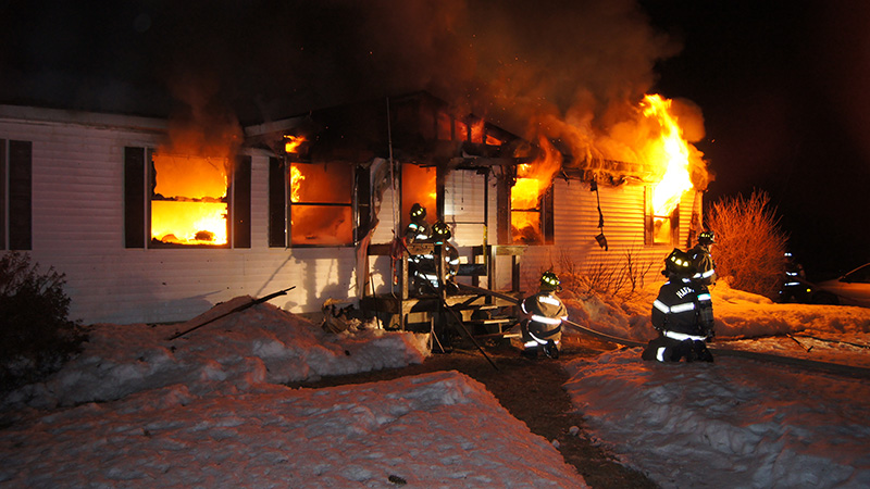 Firefighters battle a mobile home fire on Plains Road in Harrison early Friday morning.