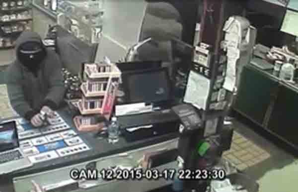 "These images from surveillance video show the suspect in a robbery at the Gulf Express Mart on Congress Street Tuesday night. Anyone with information about the robbery is asked to contact Portland police. To provide information anonymously,  mobile phone users can text the keyword ""GOTCHA"" plus their message to 274637 (CRIMES). Tips can also be submitted by going to the Portland Police Department website: www.portland-police.com and clicking"