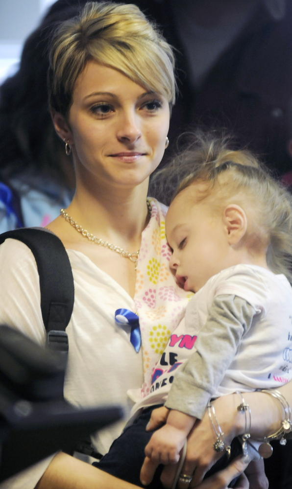Jamie Davis of New Sharon holds her daughter, Addilyn, on Monday before attending a hearing about a bill requiring screening of newborns for Krabbe's disease. Davis has raised awareness of the disease, a genetic disorder of the central nervous system, on a Facebook page followed by 107,000 people since her daughter was born with it in 2011.