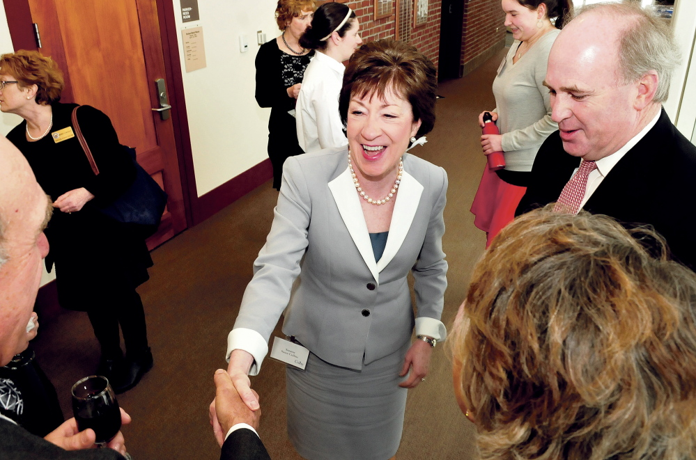 U.S. Sen. Susan Collins greets well-wishers after arriving for a dinner and speaking engagement at Colby College in Waterville on Thursday.