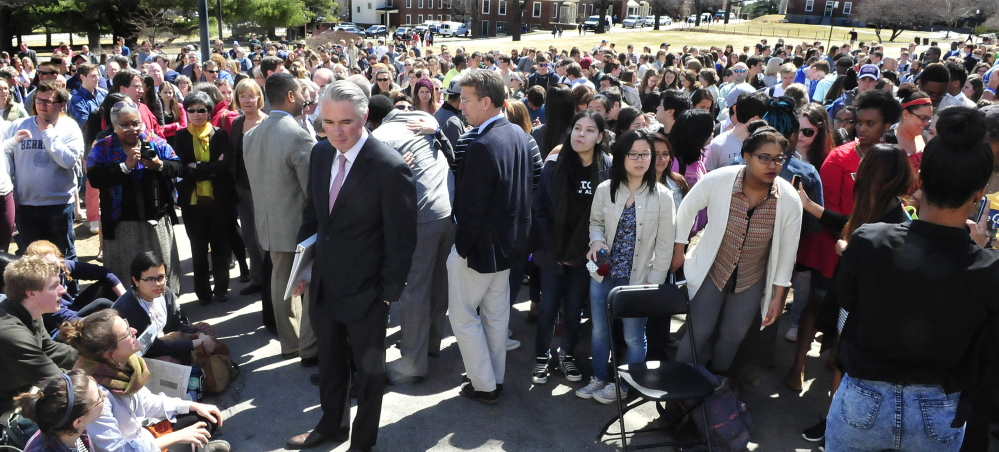 Colby College President David Greene, center, makes his way through more than 500 students and staff to speak during a racial forum on campus in Waterville on Thursday.