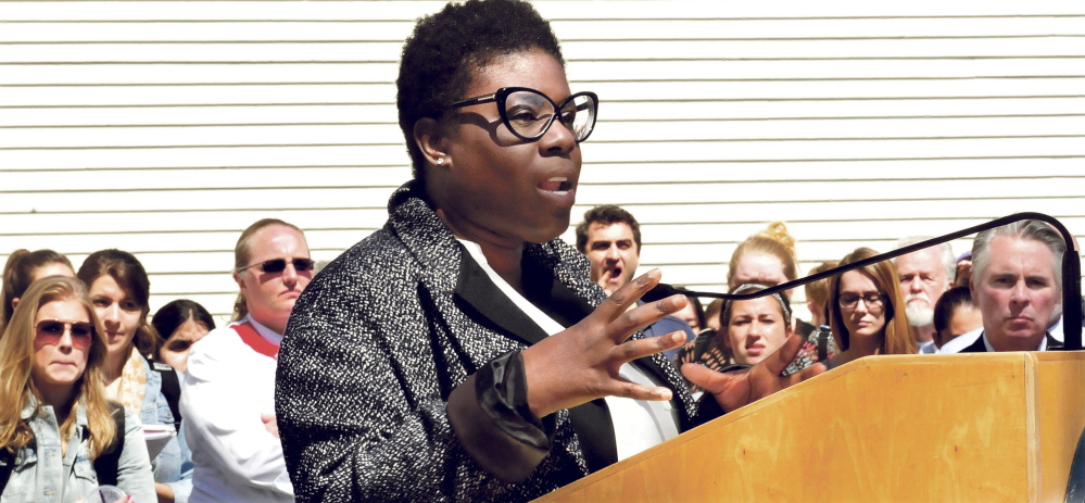 Colby College Associate Dean of Students Tashia Bradley speaks to a gathering of students and staff on racial issues during a forum on campus in Waterville on Thursday.