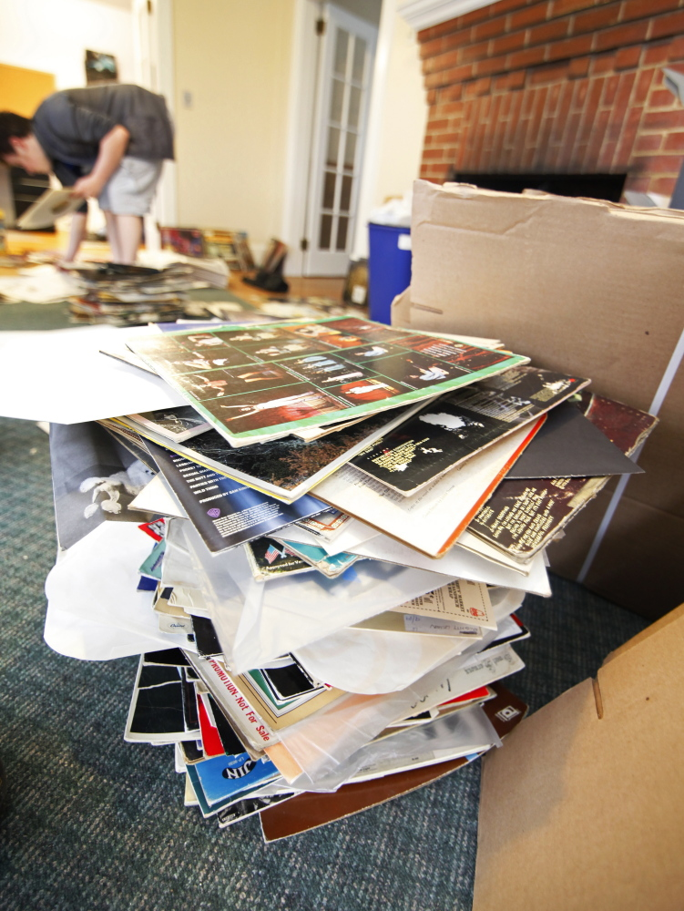 Water damaged vinyl record sleeves are stacked as WMPG scrambles to save its blues records following a flood in its studios Wednesday night, April 22, 2015 at USM in Portland. (Photo by Jill Brady/Staff Photographer)