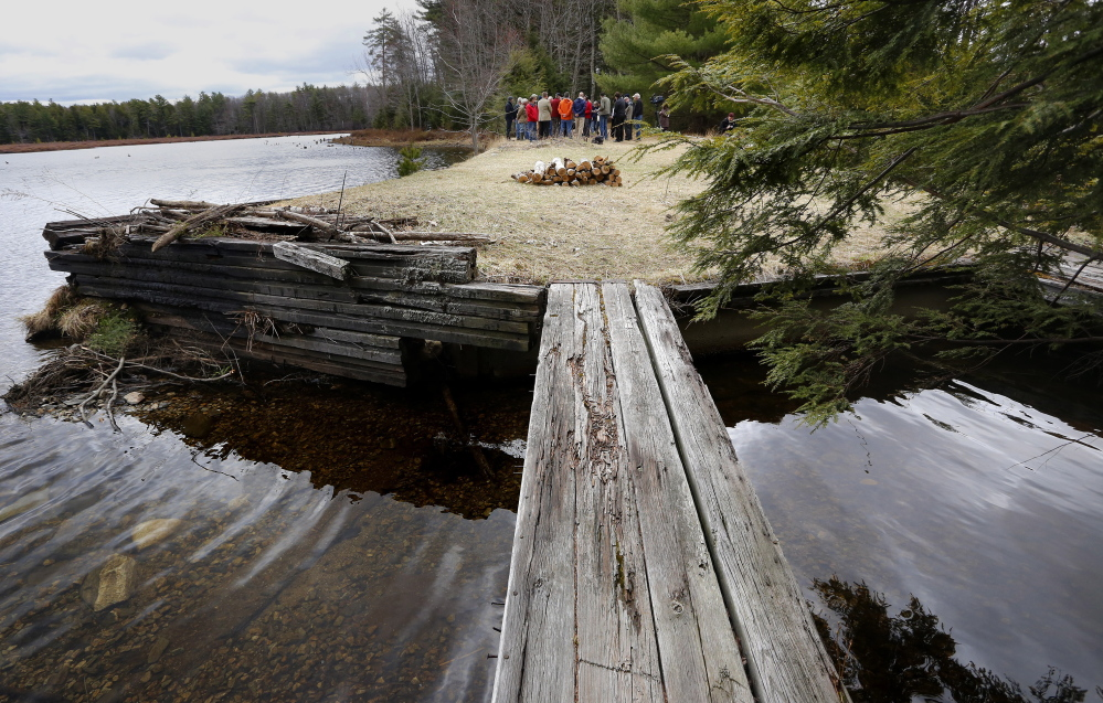 Democratic legislators and others hold a news conference Monday to pressure the governor to release millions in conservation bonds for dozens of projects, including 215 acres at Knight's Pond, above, and Blueberry Hill in Cumberland and North Yarmouth.