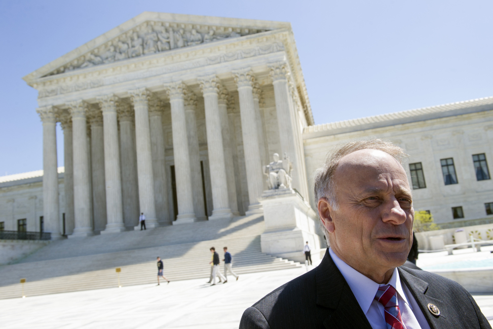 Rep. Steve King, R-Iowa, speaks with reporters in front of the Supreme Court in 2015.