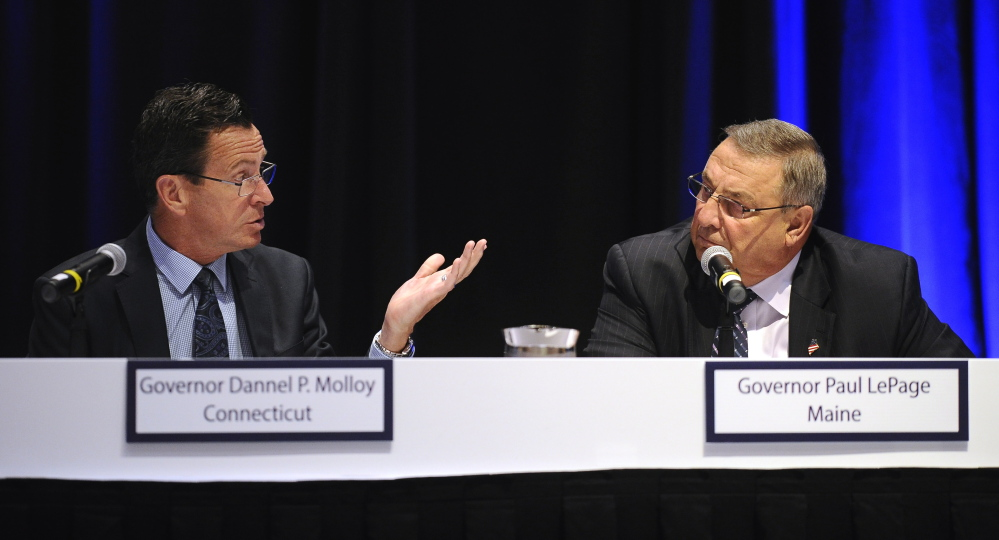 Connecticut Gov. Dannel P. Malloy, left, talks with Maine Gov. Paul LePage during a panel meeting, April 23, in Hartford, Conn. New England's governors met to update their long-term energy strategy. Now, LePage wants to strip voters of their right to decide on small nuclear power plants.