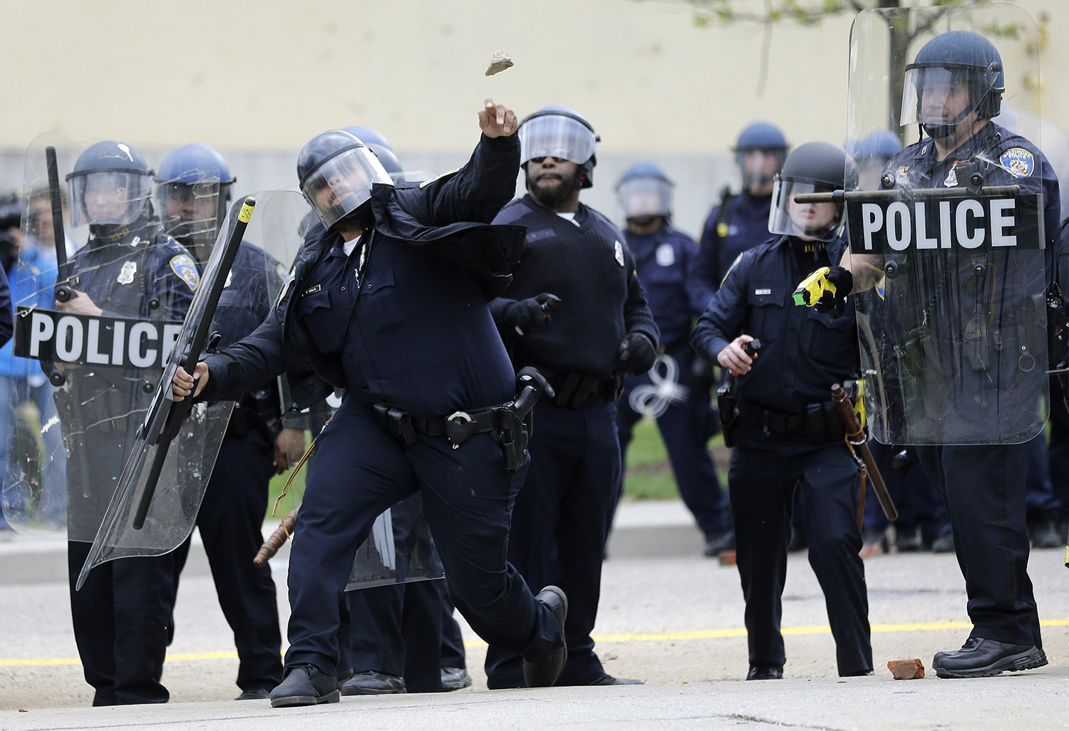 Baltimore police officers in riot gear push protestors back along - Baltimore Police Officers In Riot Gear Push Protestors Back Along 6
