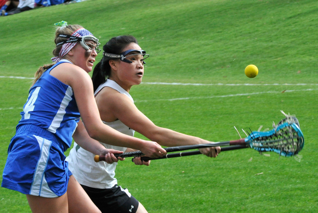 Kennebunk's Carly Sandler and Waynflete's Helen Gray-Bauer chase the ball during Kennebunk's high school girls' lacrosse victory May 4.