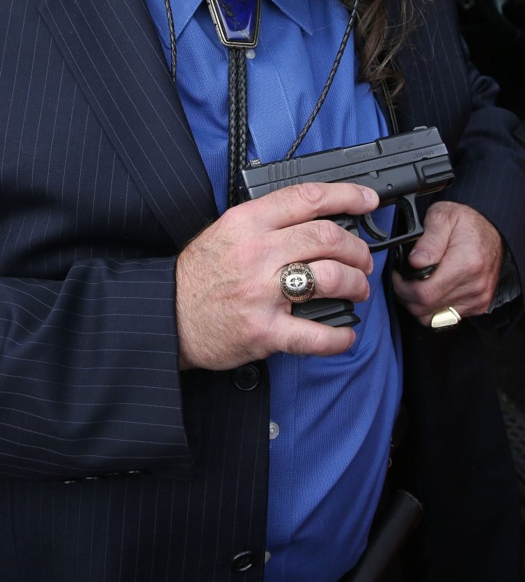 The man – and society – would be better off carrying the Constitution, concealed or otherwise, instead of a handgun.