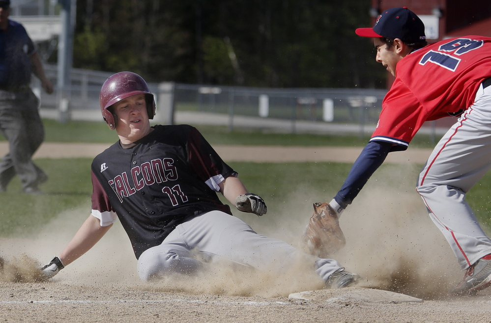 Peter Lamagna of Freeport slides safely into third with a stolen base Wednesday, beating a tag by John Villanueva of Gray-New Gloucester during Freeport's 4-2 victory.