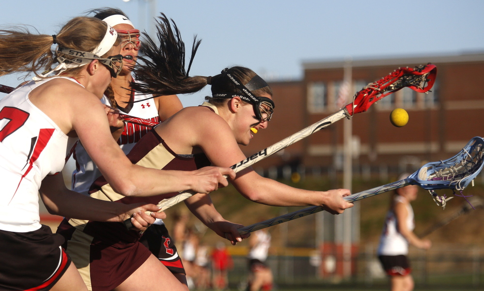 Kailey Dubuque of Thornton Academy attempts to control the ball Thursday while pressured by Kaitlin Prince, left, and Emma Smith of Scarborough during Thornton's 6-5 victory at Scarborough High. The Trojans are 3-3 and dropped the Red Storm to 3-2.