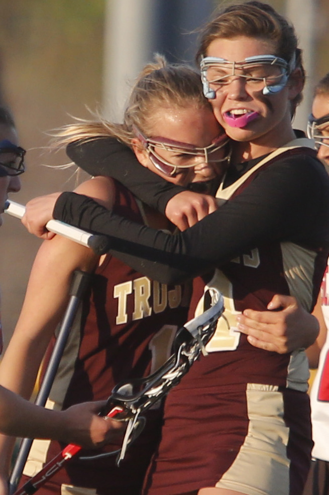 Paige LeBlanc of Thornton Academy gets a hug from teammate Faith Sinclair after scoring in the second half.