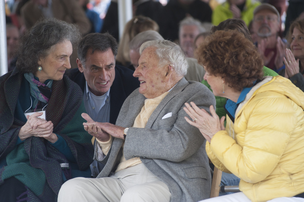 David Rockefeller, center, his daughter Neva Rockfeller Goodwin, left, and Eileen Rockfeller, right, talk at a ceremony Friday in Mount Desert marking the gift of 1,000 acres of woodlands, streams, hiking trails and carriage roads abutting Acadia National Park.